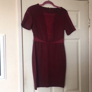 Burgundy cocktail dress with mesh cutouts
